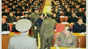 A still image taken from North Korea's state-run KRT television footage and released by Yonhap December 9, 2013, shows Jang Song Thaek being forcibly removed by uniformed personnel from a meeting of the Political Bureau of the Central Committee of the Workers' Party of Korea (WPK) in Pyongyang. North Korea on Monday excoriated Jang Song Thaek, the uncle of leader Kim Jong Un, for what it described as a slew of criminal acts, confirming the spectacular downfall of the once second most powerful man in the reclusive state. The sacking of Jang for mismanaging the economy, corruption, womanising and drug-taking comes after South Korean media reports that one of his aides has sought asylum in South Korea.   REUTERS/Yonhap  (NORTH KOREA - Tags: POLITICS MILITARY) ATTENTION EDITORS - THIS PICTURE WAS PROVIDED BY A THIRD PARTY. REUTERS IS UNABLE TO INDEPENDENTLY VERIFY THE AUTHENTICITY, CONTENT, LOCATION OR DATE OF THIS IMAGE. FOR EDITORIAL USE ONLY. NOT FOR SALE FOR MARKETING OR ADVERTISING CAMPAIGNS. NO SALES. NO ARCHIVES. THIS PICTURE IS DISTRIBUTED EXACTLY AS RECEIVED BY REUTERS, AS A SERVICE TO CLIENTS. NO THIRD PARTY SALES. NOT FOR USE BY REUTERS THIRD PARTY DISTRIBUTORS. SOUTH KOREA OUT. NO COMMERCIAL OR EDITORIAL SALES IN SOUTH KOREA